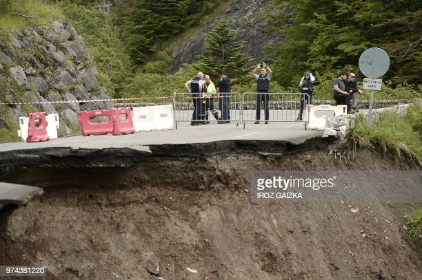 Police checks a damaged road after a landslide due to a heavy rainfall on June 14 2018 near Laruns southwestern France Tis road is part of the...