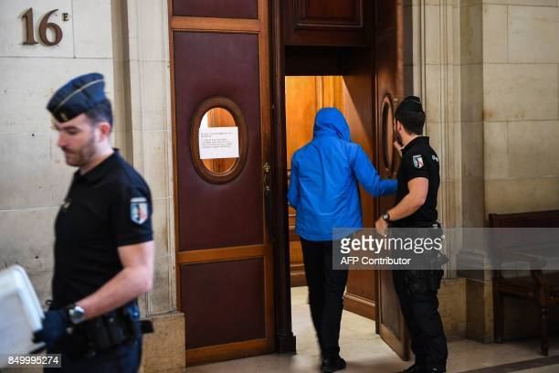 Police checks public access to enter the 16th courtroom on September 20 2017 at the Paris courthouse prior to the start of the trial of nine people...