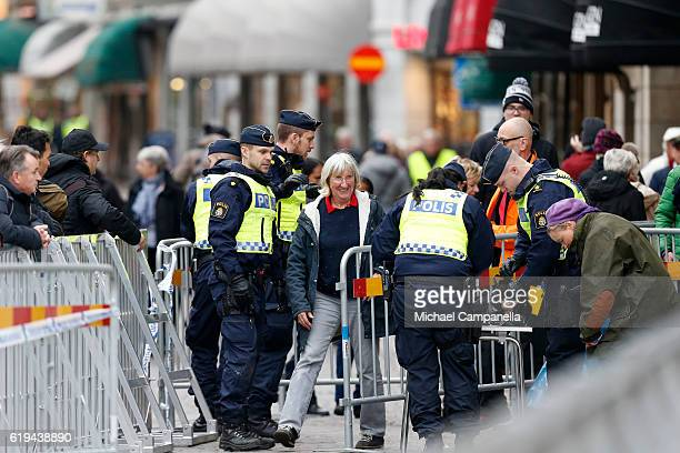 Police checks spectators prior the arrival of Pope Francis at Kungshuset on October 31 2016 in Lund Sweden The Pope is on 2 days visit attending...