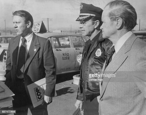Police Chief Art Dill Left Discusses Cop Program With him are Division Chief R L Jevnager James J Sadler of Yellow Cab Credit Denver Post