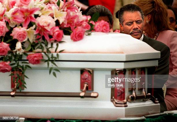 Police Chief Bernard Parks sits in front of the casket of grandaughter Lori Gonzalez during burial services at Holy Cross Cemetary in Culver City...