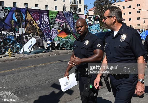 LA police chief Charlie Beck tours the Skid Row area near where the homeless man known as 'Africa' was recently shot dead during a scuffle with...