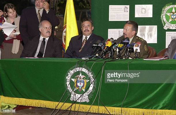 """Police chief General Luis Ernesto Gilbert Vargas, right, speaks to the press after operation """"New Generation"""" November 1, 2000 in Bogota, Colombia...."""