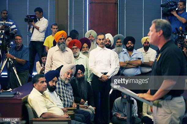 Police Chief John Edwards speaks at a press conference August 6 2012 in Oak Creek Wisconsin about the shootings Sunday at the Sikh Temple of...
