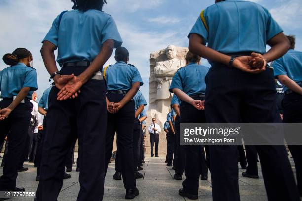 Police Chief Peter Newham meets with police cadets, officers, and recruits on the front lines of the demonstrations at the Martin Luther King Jr....