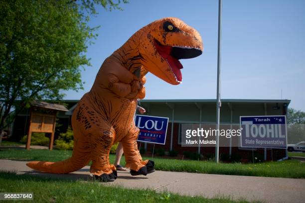 Police Chief Tony Harris exits at the Conyngham Borough Building polling station wearing a TRex costume en route to another event during the 2018...
