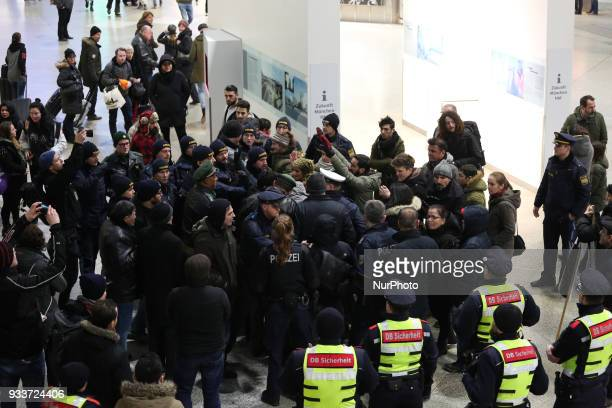 Police circled the group of activists About 3040 people protested spontaneously at the Munich Central Station against turkish war against Afrin in...