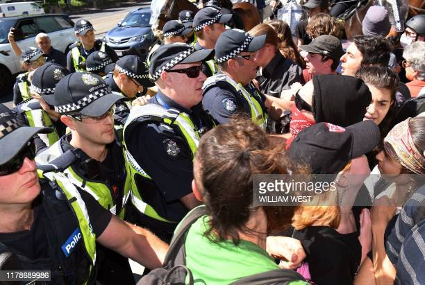Police clash with climate change protesters attempting to disrupt the International Mining and Resources Conference being held in Melbourne on...