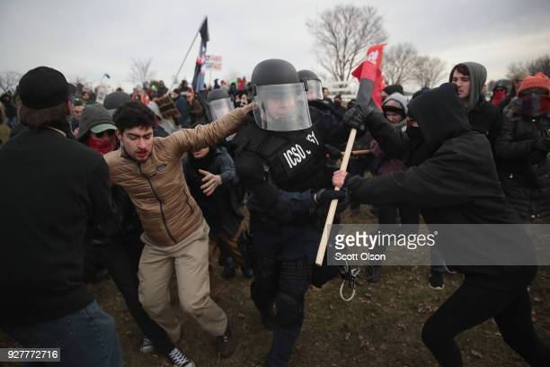 Police clash with demonstrators as they escort people into a speech by white nationalist Richard Spencer who popularized the term 'altright' at...