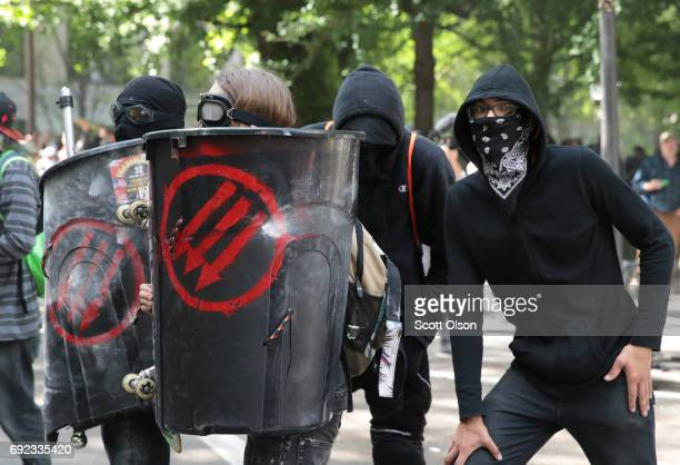 Police clash with demonstrators as they try to clear 'Antifa' members and anti-Trump protesters from the area during a protest on June 4, 2017 in...