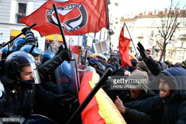 Police clash with demonstrators during an anti-fascist and anti-racist march to protest against a Lega Nord far right party general election campaign...