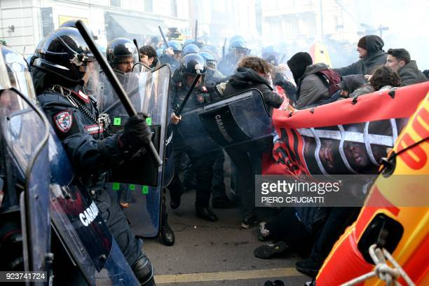 Police clash with demonstrators during an antifascist and antiracist march to protest against a Lega Nord far right party general election campaign...