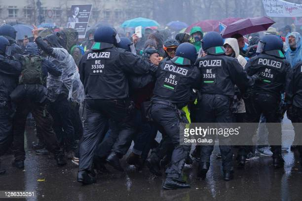 """Police clash with demonstrators during protests next to the Reichstag against modifications to a law called the """"infection protection law"""" prior to a..."""
