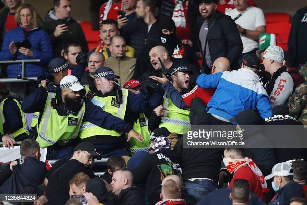 Police clash with Hungary fans during the 2022 FIFA World Cup Qualifier match between England and Hungary at Wembley Stadium on October 12, 2021 in...