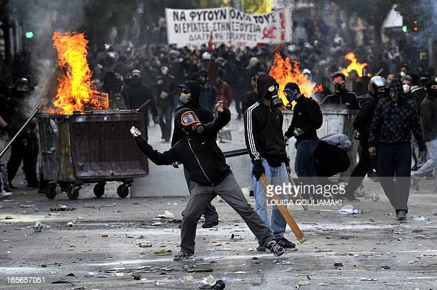 Police clash with masked demonstrators in Athens on October 20 2011 Clashes have broken out in central Athens between rival groups of demonstrators...