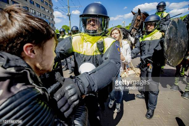 Police clash with people demonstrating against the measures to curb the spread of the COVID19 in The Hague on May 5 2020 / Netherlands OUT
