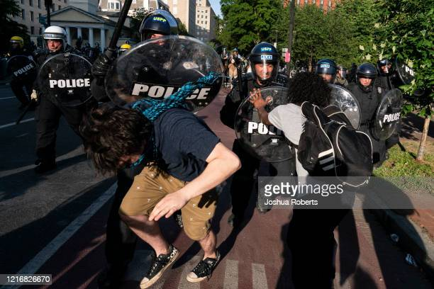Police clash with protesters during a demonstration on June 1, 2020 in Washington, DC. Thousands of protesters took to the streets throughout...