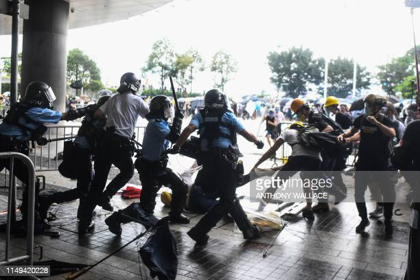 TOPSHOT Police clash with protesters during a demonstration outside the Legislative Council Complex in Hong Kong on June 12 2019 Violent clashes...