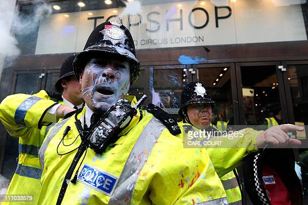 Police clash with protesters outside the Topshop store in central London, during a mass demonstration against government financial cuts, on March 26,...