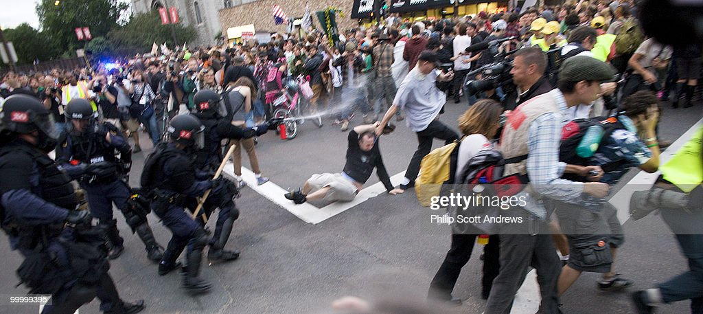Police clash with protestors as the attempt to detain a man who had walked into a police barricade. The man is dragged to safety by another protester after he was pepper sprayed.