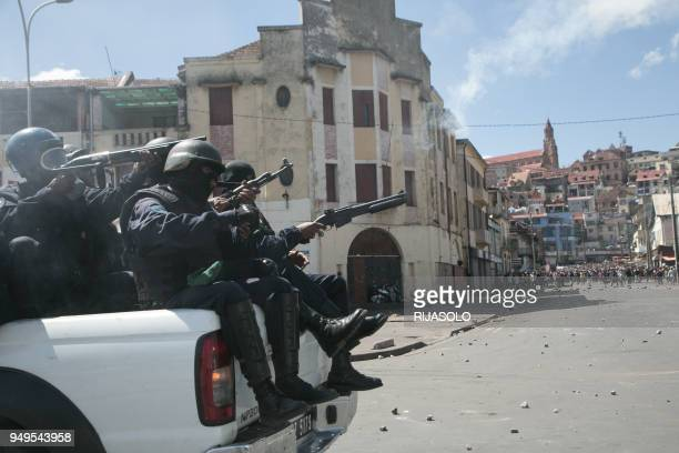 Police clash with protestors during a opposition demonstration against a draft electoral law adopted by Madagascar's National Assembly on April 21,...