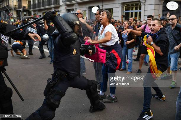 Police clash with protestors following a week of protests over the jail sentences given to separatist politicians by Spain's Supreme Court, on...