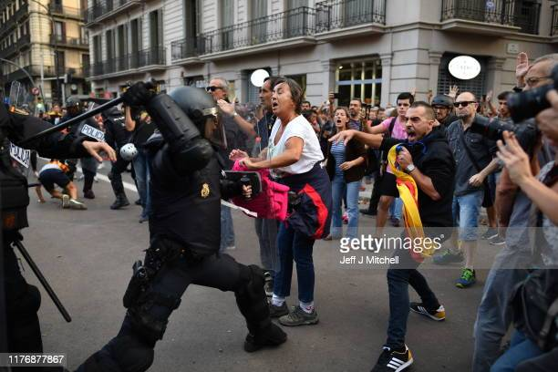 Police clash with protestors in the streets following a week of protests over the jail sentences given to separatist politicians by Spain's Supreme...
