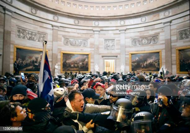 Police clash with supporters of US President Donald Trump who breached security and entered the Capitol building in Washington D.C., United States on...