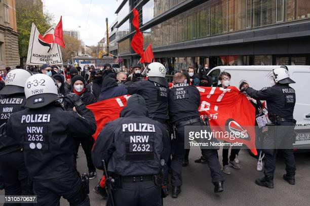 Police clashes with counterprotester during a protest of the Querdenken movement marching for what they claim are their basic rights during the third...