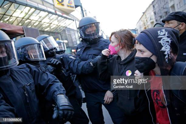 """Police clashes with demonstrators during the annual """"Revolutionary May 1"""" leftist protest march on May Day during the third wave of the coronavirus..."""