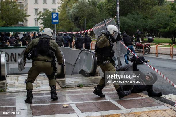 Police clashes with protesters on December 6 2018 in Athens during a demonstration to commemorate the 10th anniversary of fatal shooting of a...