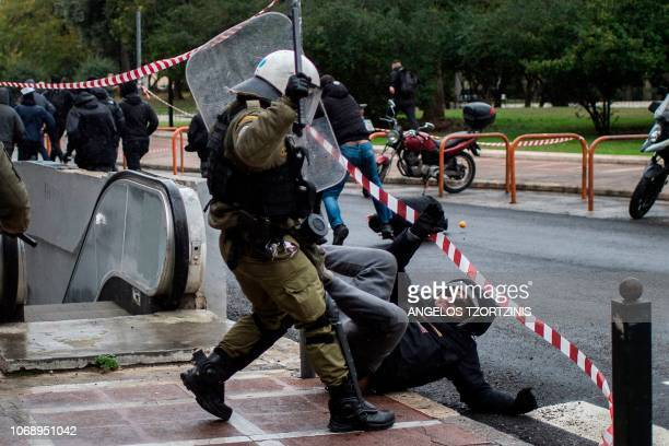 TOPSHOT Police clashes with protesters on December 6 2018 in Athens during a demonstration to commemorate the 10th anniversary of fatal shooting of a...