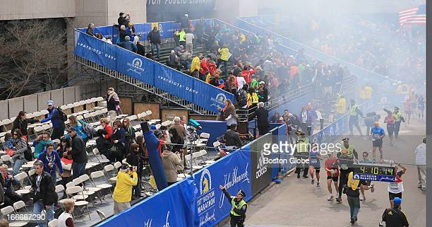 Police clear the bleachers after two explosions went off near the finish line of the 117th Boston Marathon on April 15 2013