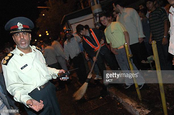 TEHRAN IRAN Police clear the site of an explosion at Imam Hussein Square in Tehran Iran on Sunday June 12 2005