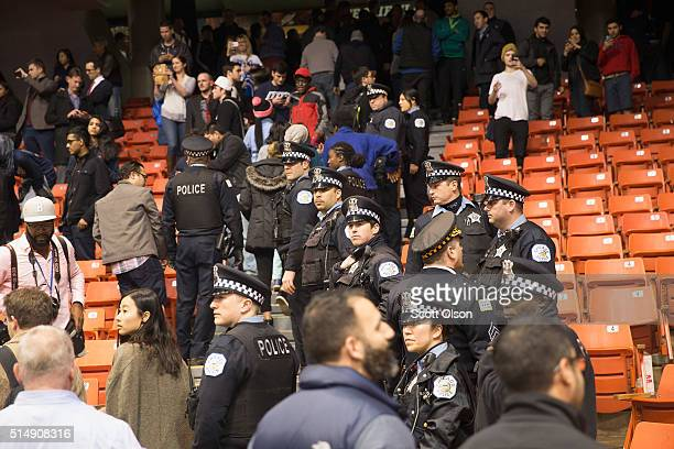 Police clear the stadium after it was announced that a rally with Republican presidential candidate Donald Trump at the University of Illinois at...