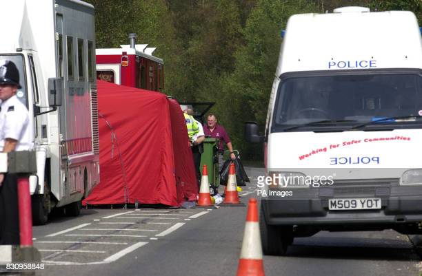 Police clearing up after the forensic teams at the police road block near Yateley Heath in Hampshire where the remains of missing schoolgirl Amanda...