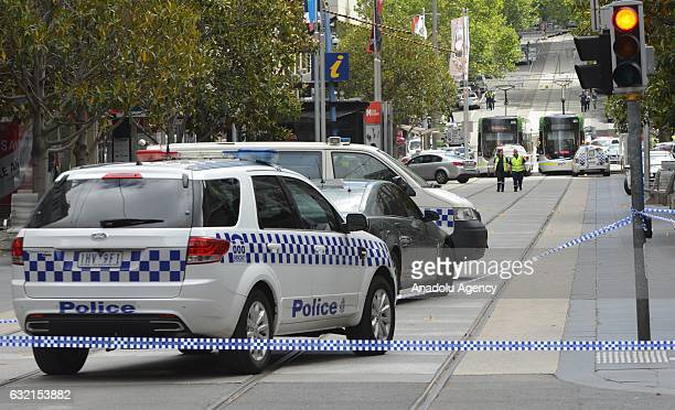 Police close a road to traffic after a man deliberately drove into a crowd in Melbournes Bourke St Mall in Australia on January 20 2017 Three people...