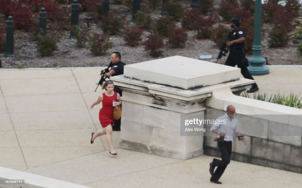 Police close in on the U.S. Capitol as people run for cover after reports of a shooting October 3, 2013 on Capitol Hill in Washington, DC. The US Capitol and the White House were placed on lockdown after an 'active shooter' situation was reported.