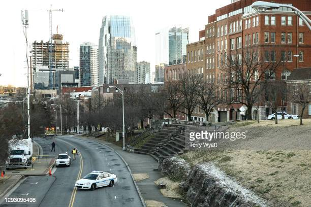 Police close off an area damaged by an explosion on Christmas morning on December 25, 2020 in Nashville, Tennessee. A Hazardous Devices Unit was en...