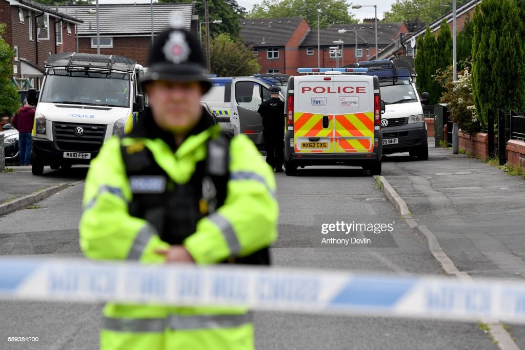 Police close the road leading to Quantock Street in the Moss Side area of Manchester where a raid was carried out earlier on May 28, 2017 in Manchester, England. Security in the city remains high since the Manchester Arena suicide bombing which killed 22 people on the evening of May 22 as concert goers were leaving the venue after an Ariana Grande performance.