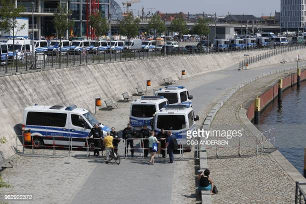 Police closes the path along the river Spree which lead to the main station in Berlin where Alternative for Germany 's demonstrators gather to attend...