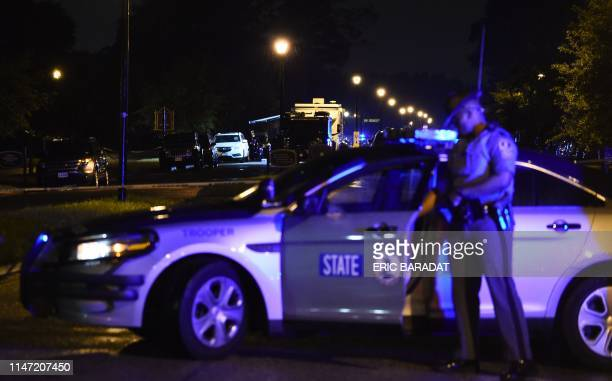 A police command post truck is seen in the background while a state trooper blocks access to the Virginia Beach municipal center the site of a mass...