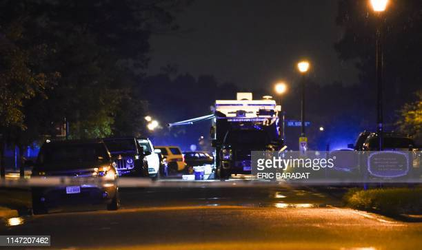 A police command post truck is seen in the distance while a police tape blocks access to the Virginia Beach municipal center the site of a mass...