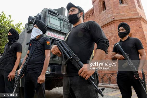 Police commando personnel stand guard ahead of the 36th Operation Blue Star anniversary in Amritsar on June 5, 2020. - The Indian military's June...