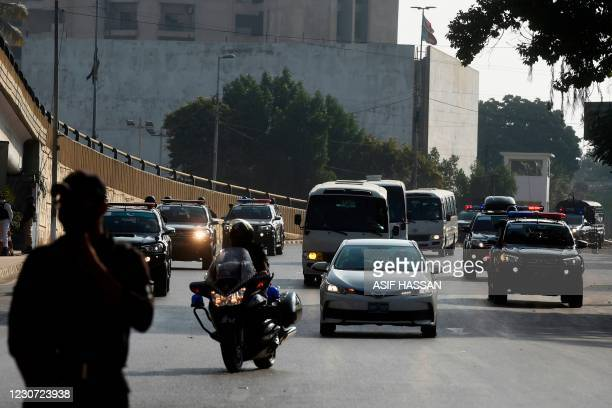 Police commando stands guard outside the National Stadiumas Pakistan's cricket team arrive to attend a practice sessionin Karachi on January 22...