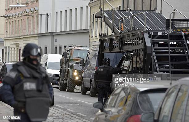 Police commandos raid the club house of the Hells Angels in Vienna Austria on January 4 2017 A German murder suspect was arrested during the raid /...