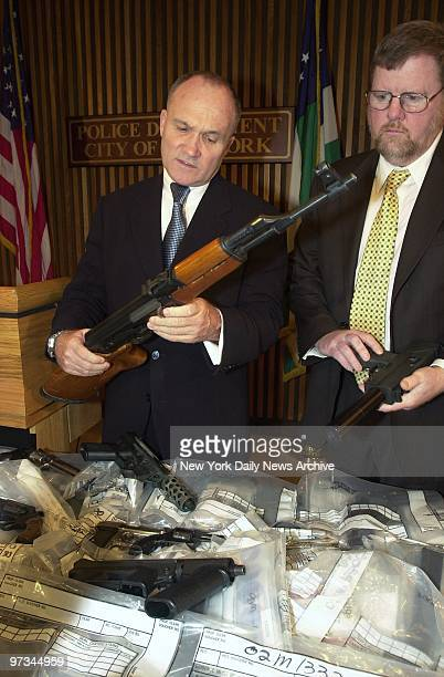Police Commissioner Raymond Kelly and Deputy Commissioner Paul Browne look over some of the arsenal of weapons sold to undercover cops at a Brooklyn...