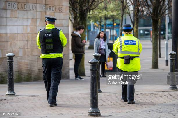Police Community Support officers patrol Piccadilly Gardens in central Manchester on March 30, 2020 in Manchester, United Kingdom. The Coronavirus...