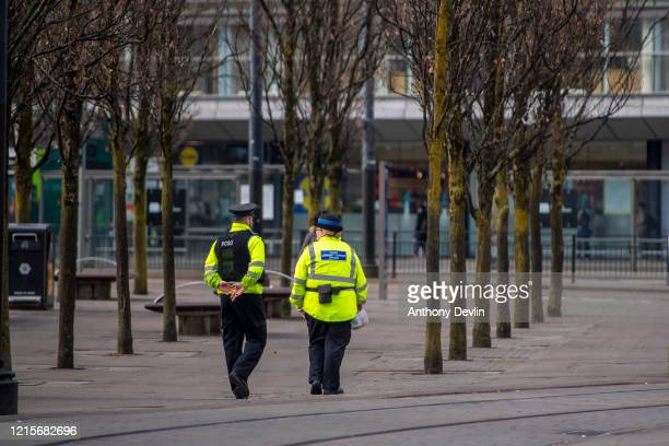 Police Community Support officers patrol Piccadilly Gardens in central Manchester on March 30 2020 in Manchester United Kingdom The Coronavirus...