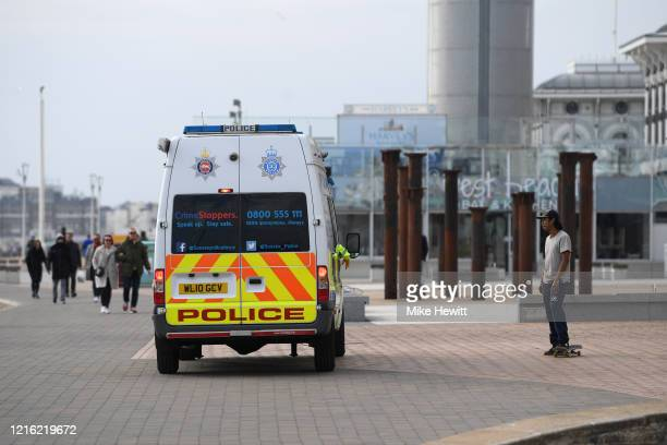 Police community support officers patrolling Brighton seafront talk to a skateboarder on April 01, 2020 in Brighton, England. The Coronavirus...